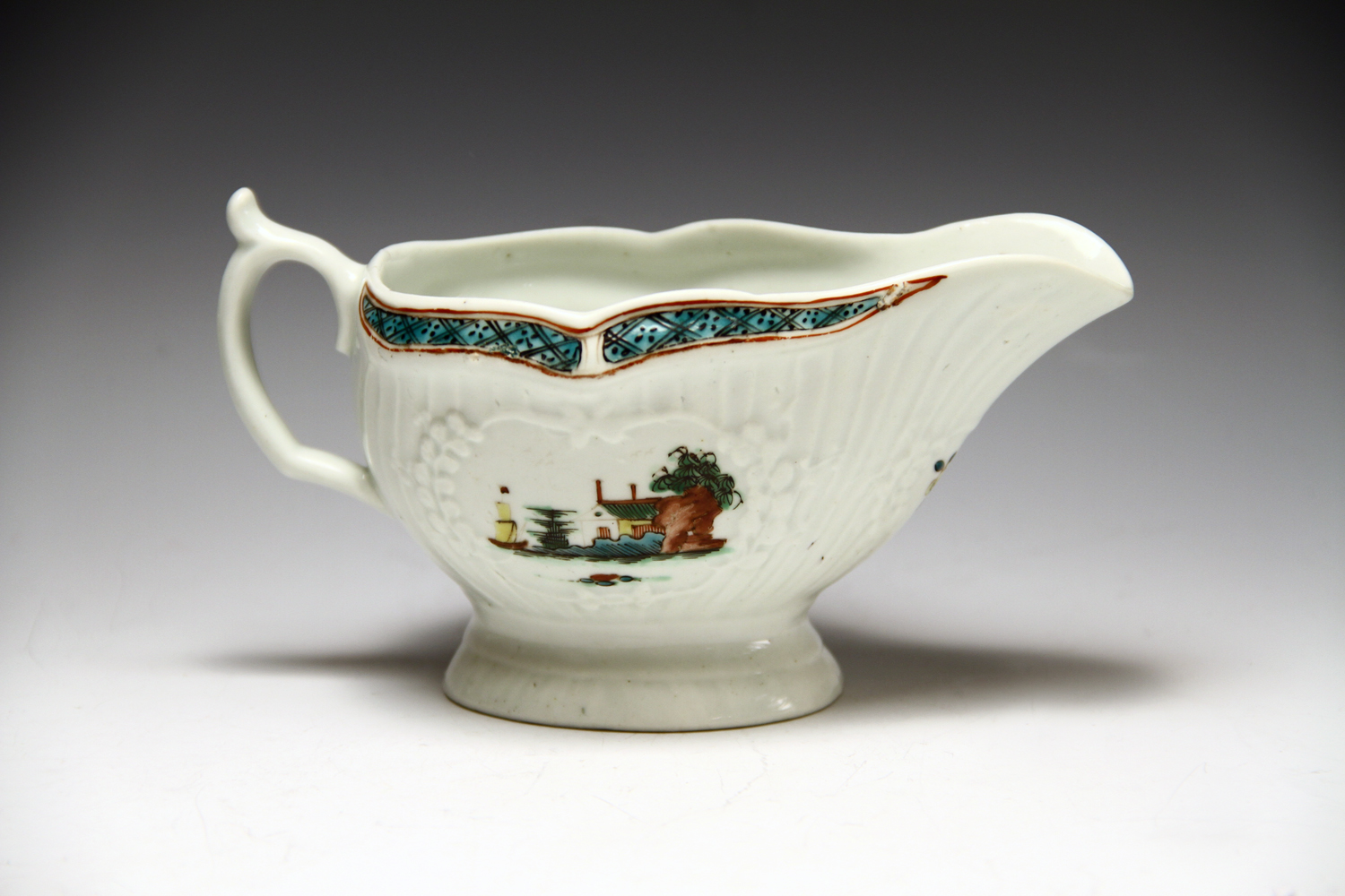 1030 - A fine Worcester polychrome sauceboat c 1758