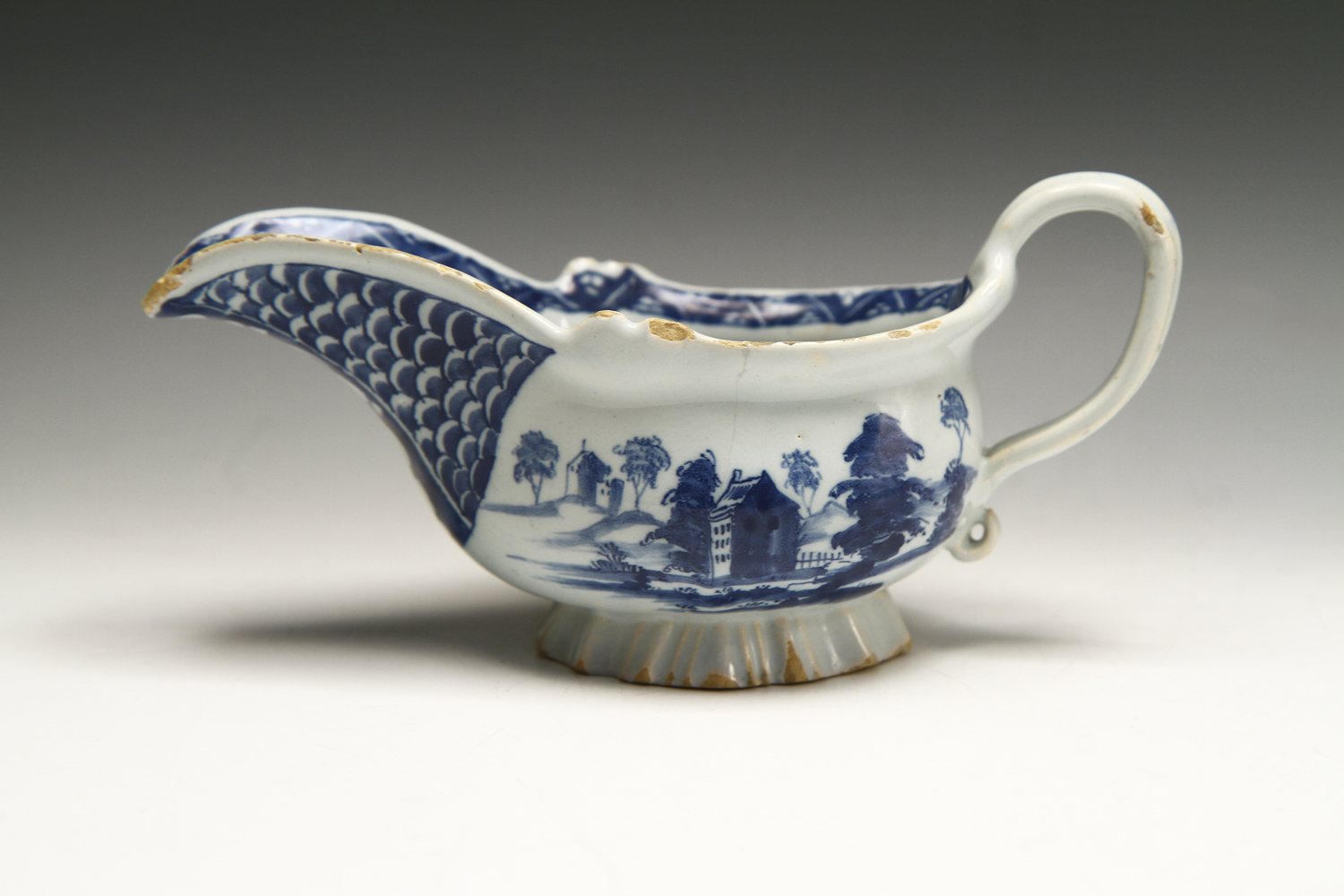1015 - Interesting small English delft sauceboat c 1750-55