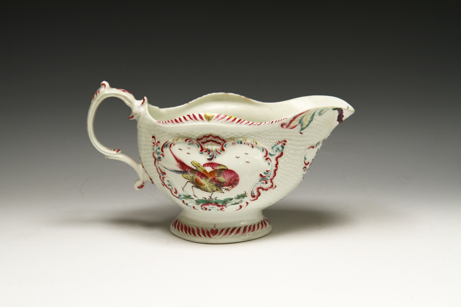 1001 - Finely potted Worcester sauceboat c 1765-8.
