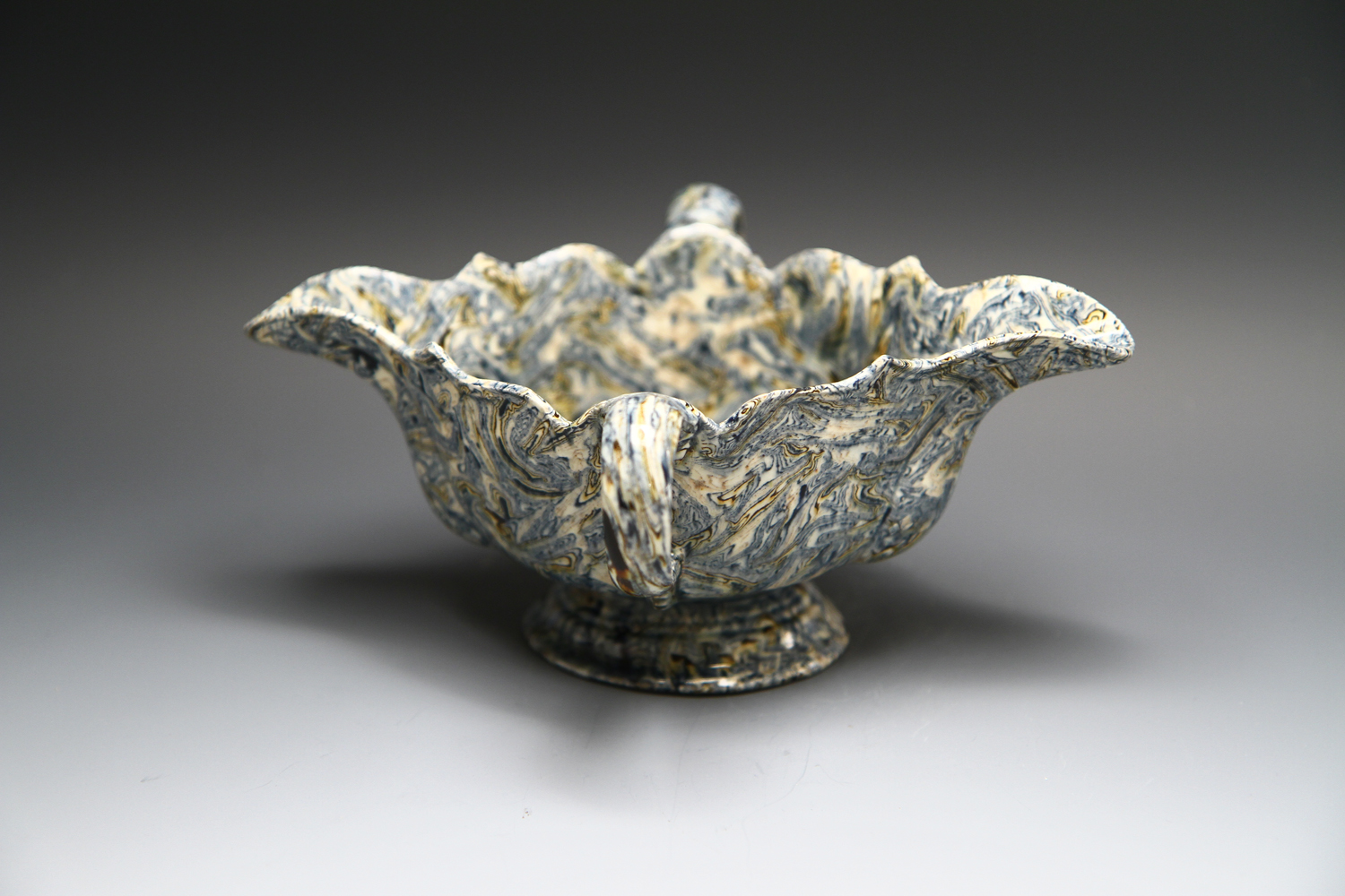 1086 - An agateware double handled sauceboat c 1750