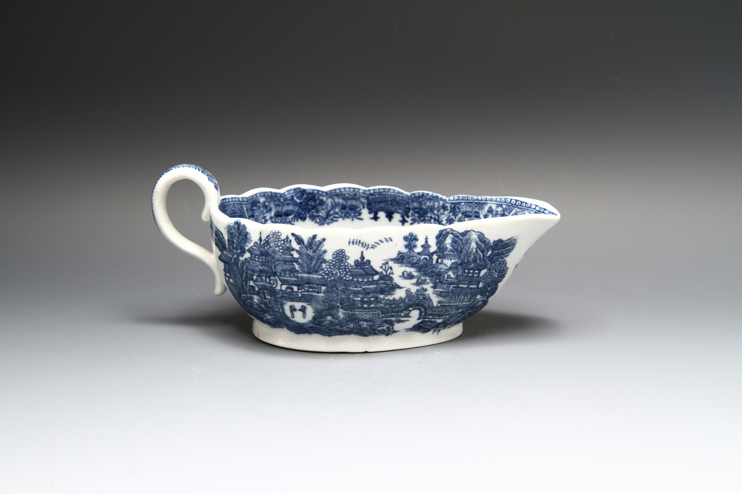 1127 - A low fluted Caughley sauceboat c 1785-90