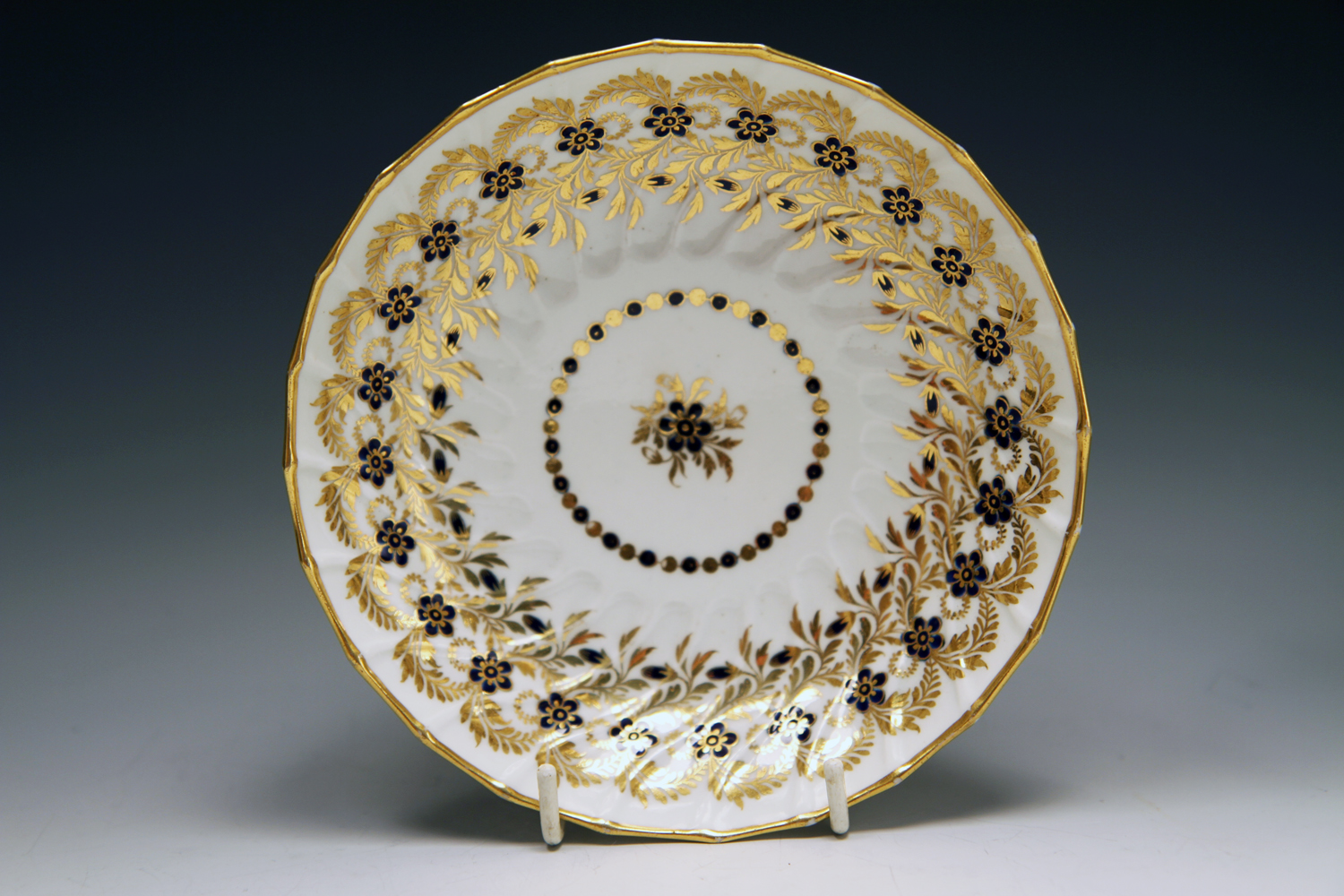 1034 - Worcester spirally fluted teacup and saucer c 1785