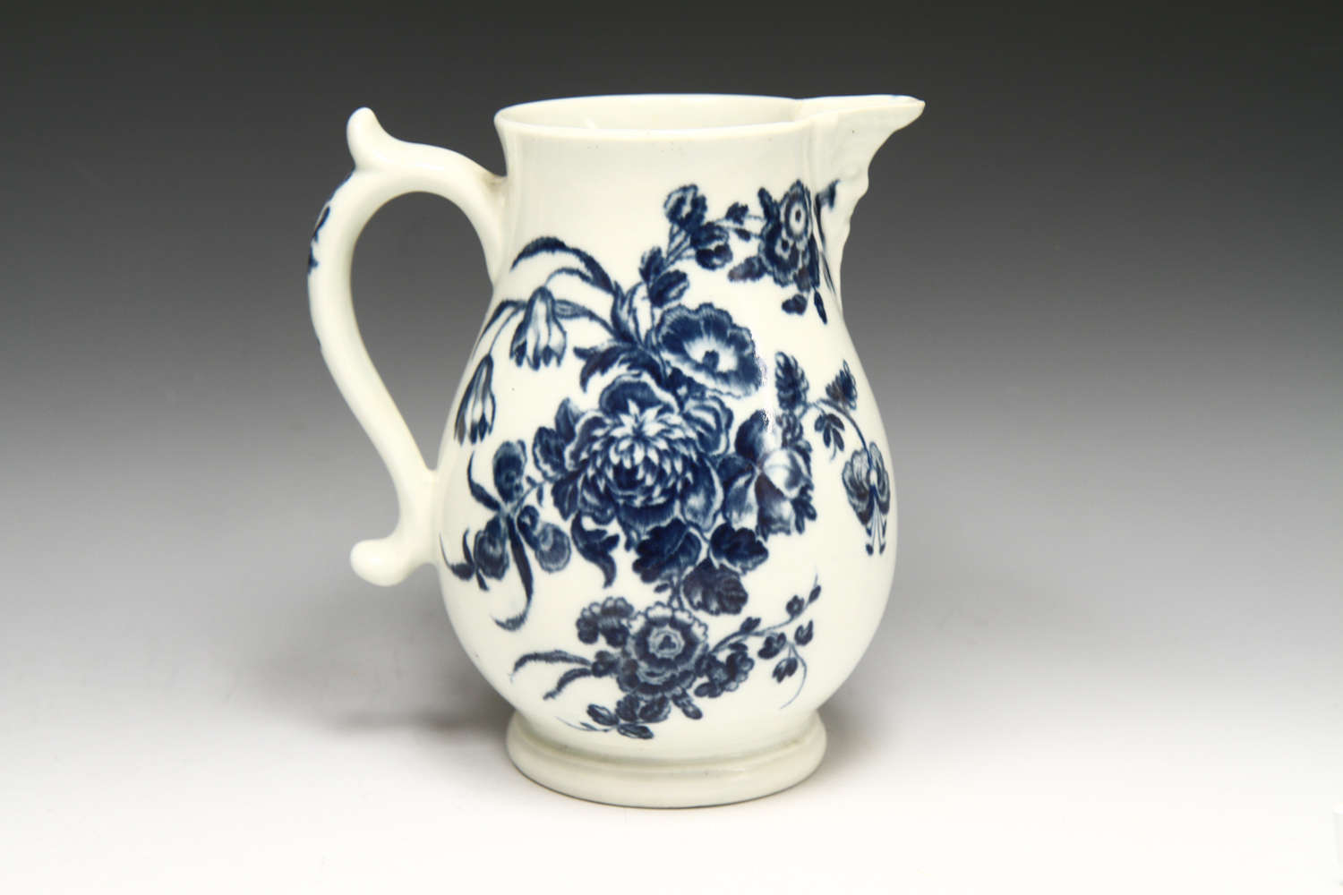 1067 - A Worcester mask head jug c 1775-80