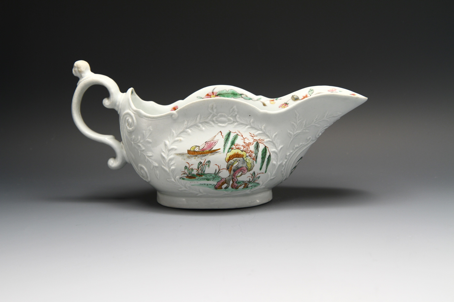 1105 - A fine Worcester sauceboat with dog's head handle, c 1753-4