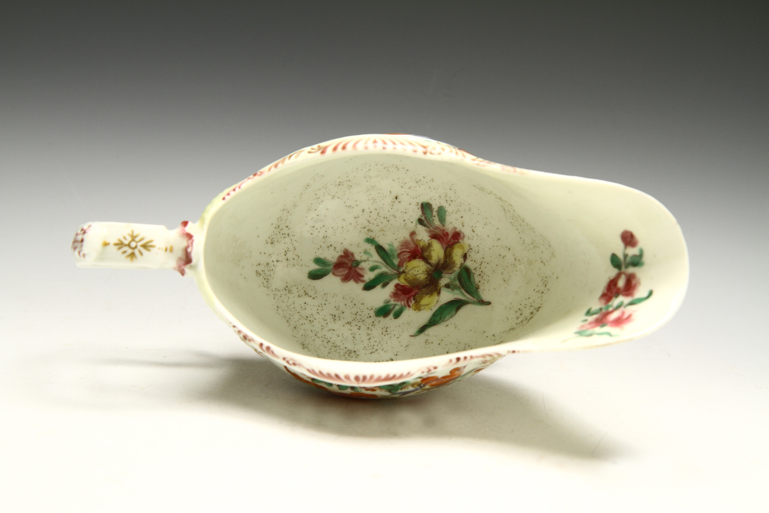 1014 - A Rare yellow ground Worcester sauceboat c 1765-8