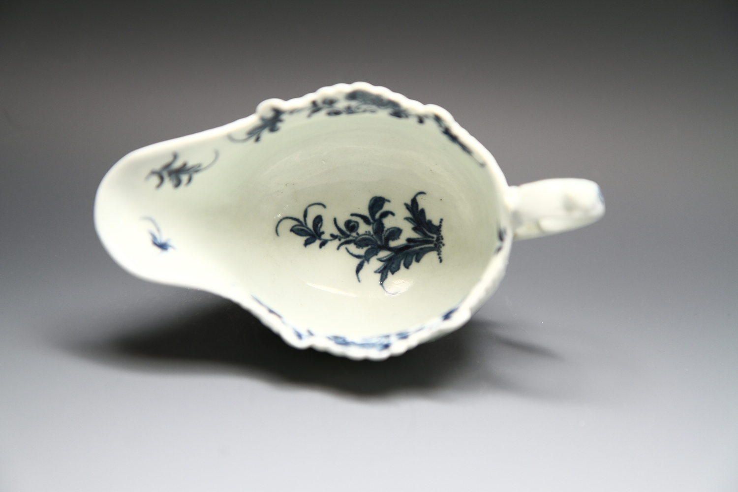 1092 - A small Worcester sauceboat with the Two Porter Landscape pattern c 1768-70