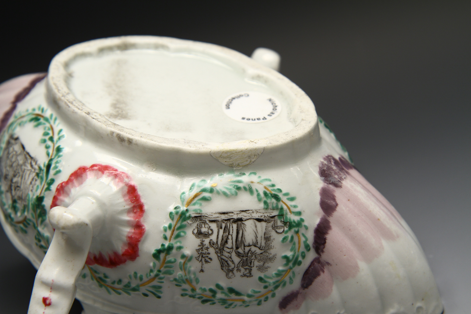 1115 - A rare Worcester printed and polychrome painted double handled sauceboat c 1755